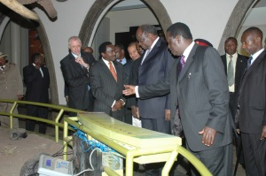 President and Prime Minister, with other dignitaries, comparing their weights to those of animals, with interactive display