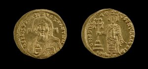 Gold coin.(obverse) draped bust of Christ, with flowing hair and beard, facing with cross behind head, in act of benediction and holding Gospels. (reverse) diademed and draped standing figure of Justinian II, holding cross potent and mappa. 1852,0903.23  © The Trustees of the British Museum