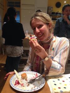 Tugba elegantly eating a traditional British scone.