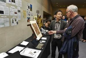 Huan Zhang (China) discussing his Room 3 Proposal with Adrian Doyle, Preventive Conservator